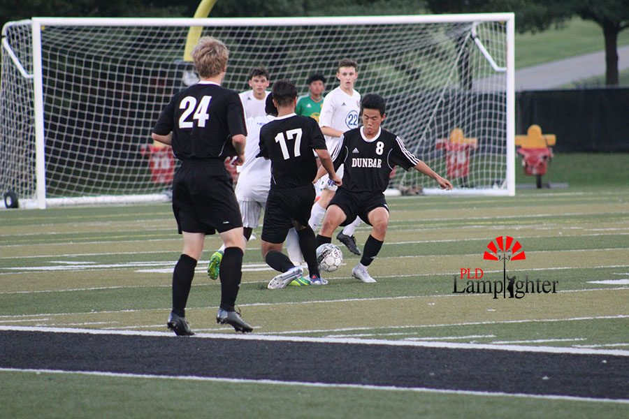 #24,  stands behind to be open for a pass that his teammates, #17 Pablo Ortis, and #8 Kevin Jing will make to him.