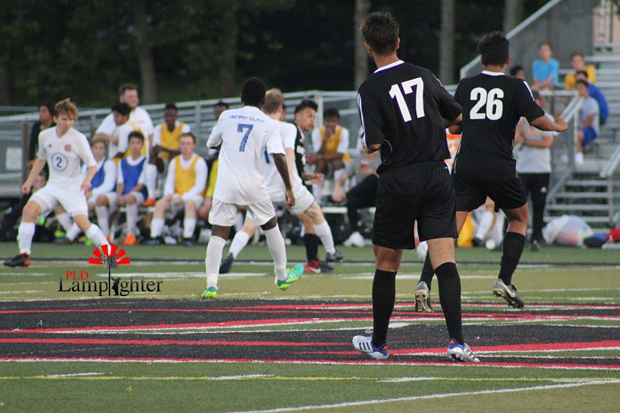 Pablo Ortis #17 and #26 run across the field to help out their teammate surrounded by opponents.