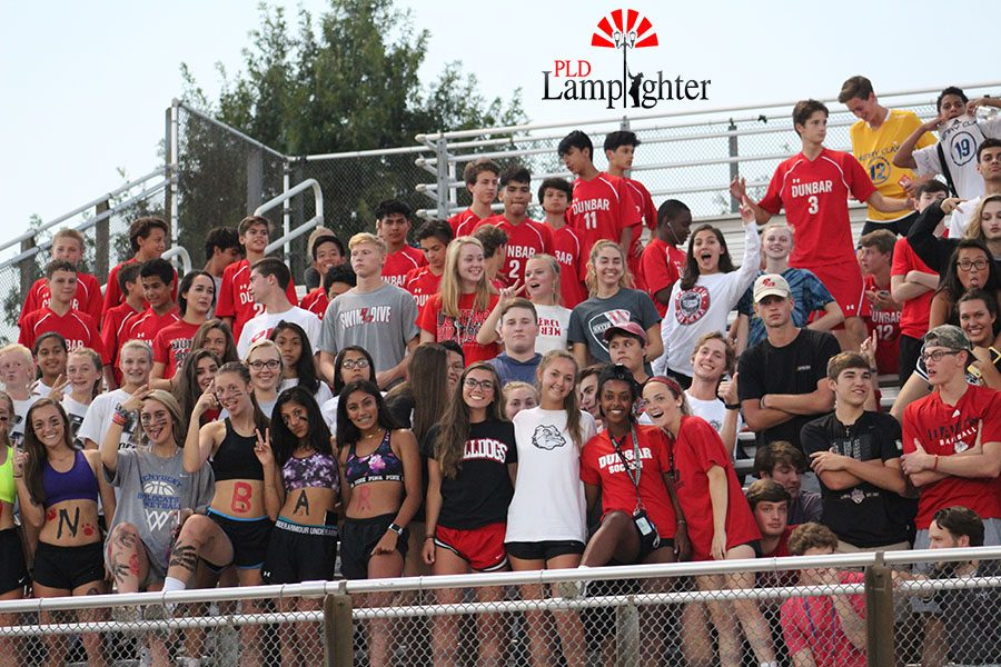 Dunbar's Dawg Pound is filled with supportive students and the JV team while the varsity boy soccer players take the field.