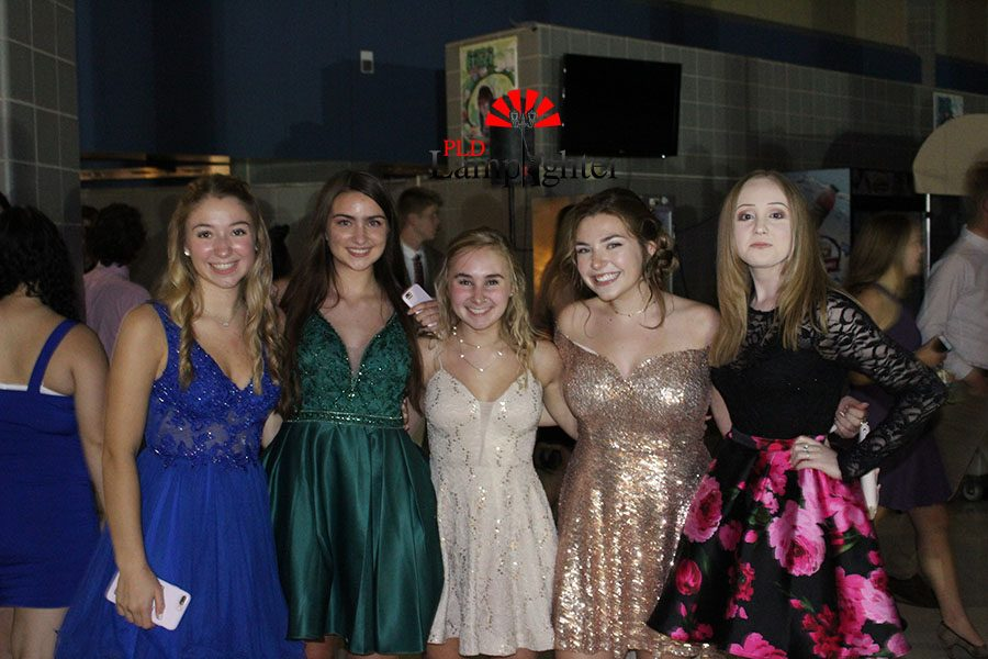 These girls show off their variety of homecoming dresses.