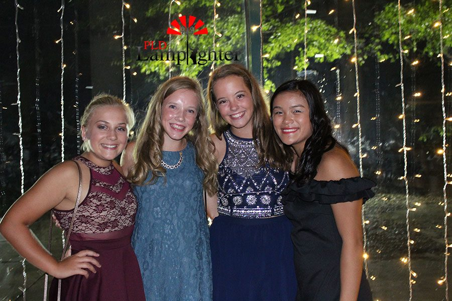 These beautiful young ladies use the string lights as their backdrop to match their sparkly dresses.