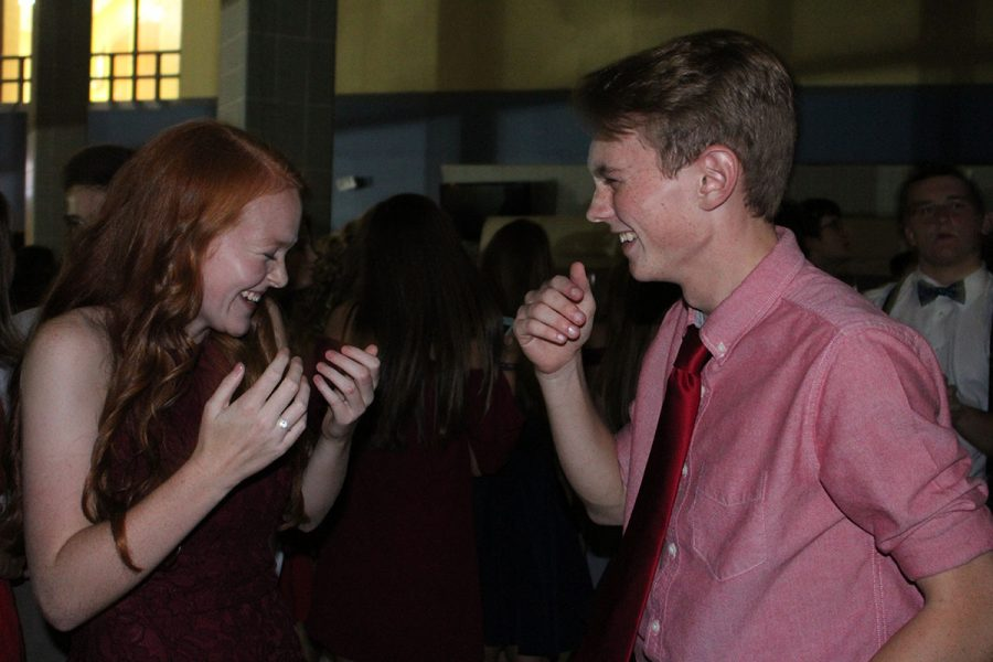 Parker Smith and his date Abby Fister laugh.