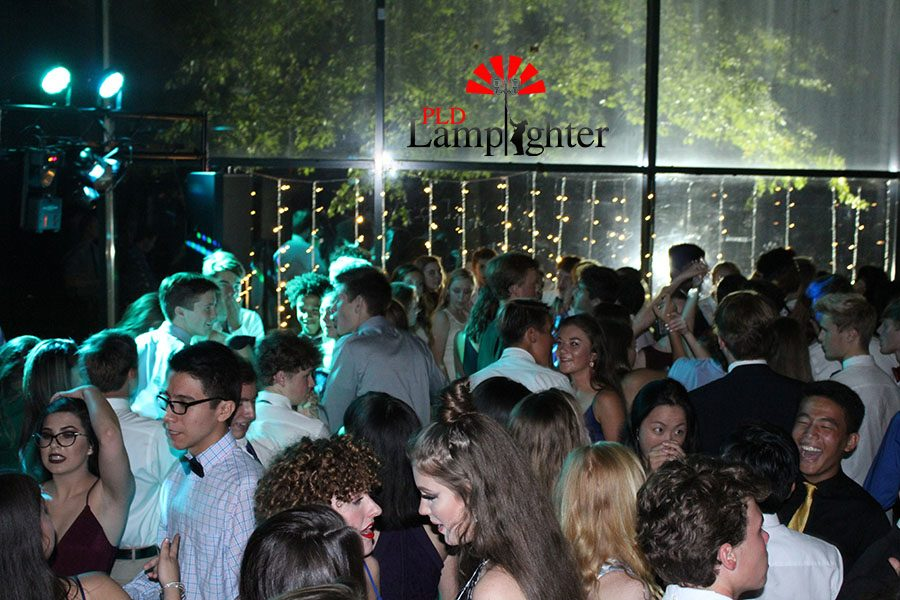 The dance floor is full of excitement and laughter all around.