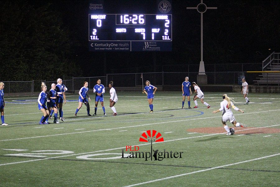 #4 Audrey Rawls takes a free kick at the 20 yard line to attempt Paul Laurence Dunbar's third goal.