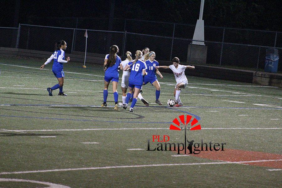 #18 Olivia Paulson and #16 Tori Scott attempt to take back possession of ball.