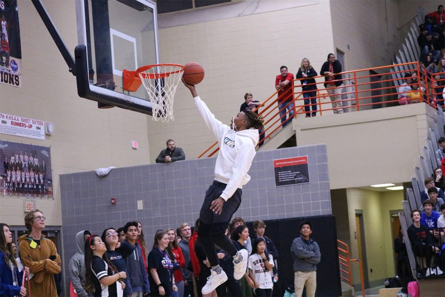 One of Dunbar's freshman showing the proper way to do a layup during one of the relay games.