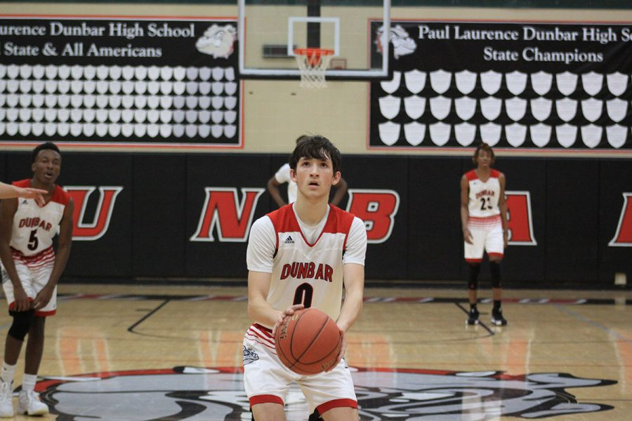 #0 Grayson Shively gets ready to shoot a free throw after being fouled by a defender.