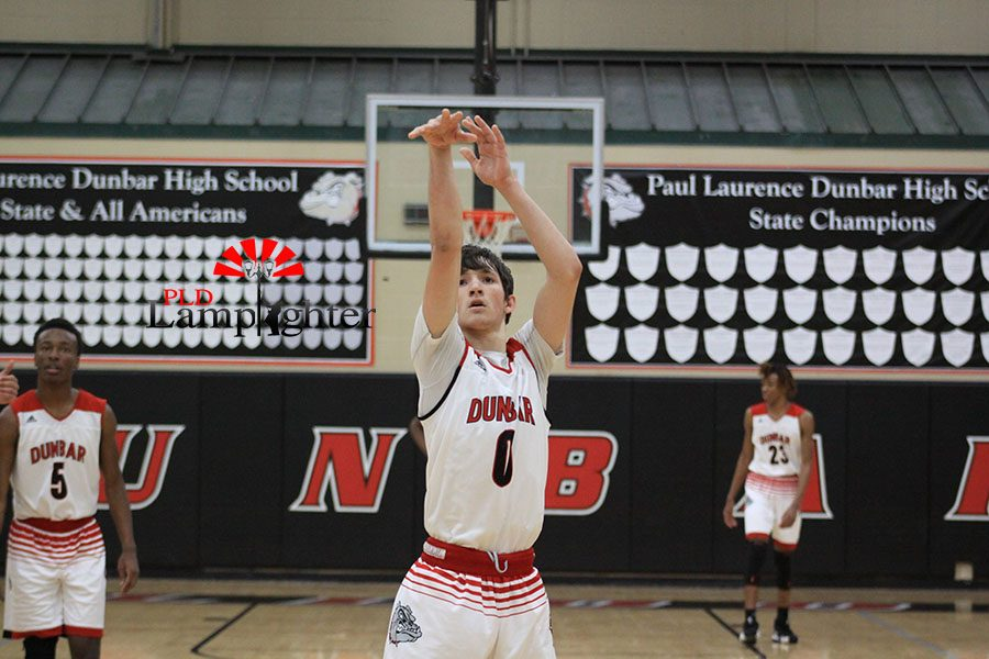 #0 Grayson Shively shoots a free throw after being fouled on a three point shot.