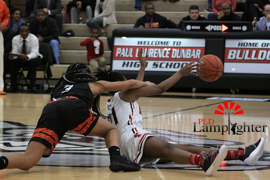 #21 Aziah Campbell passes the ball to avoid getting a travel call.