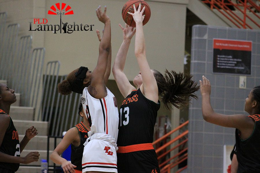#12 DelTarria Jackson goes up for a rebound after a missed shot by Dunbar.