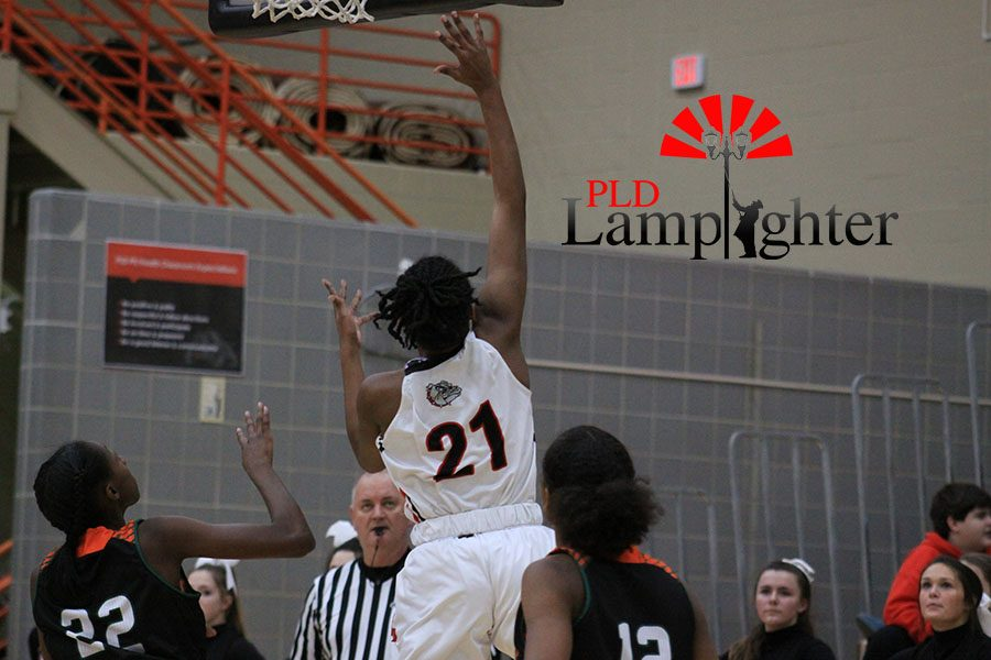 #21  Aziah Campbell shoots a layup to try and increase Dunbar's lead.