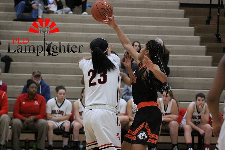 #23 Tanaya Cecil passes the ball before Fredrick Douglass's defense can force a turnover.