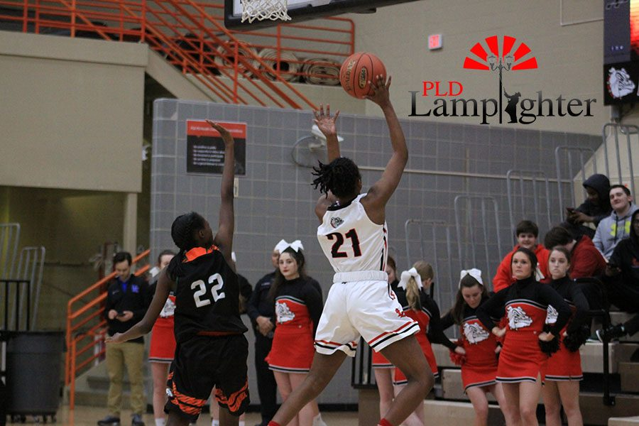 #21 Aziah Campbell shoots a layup after stealing the ball and having a wide open shot.