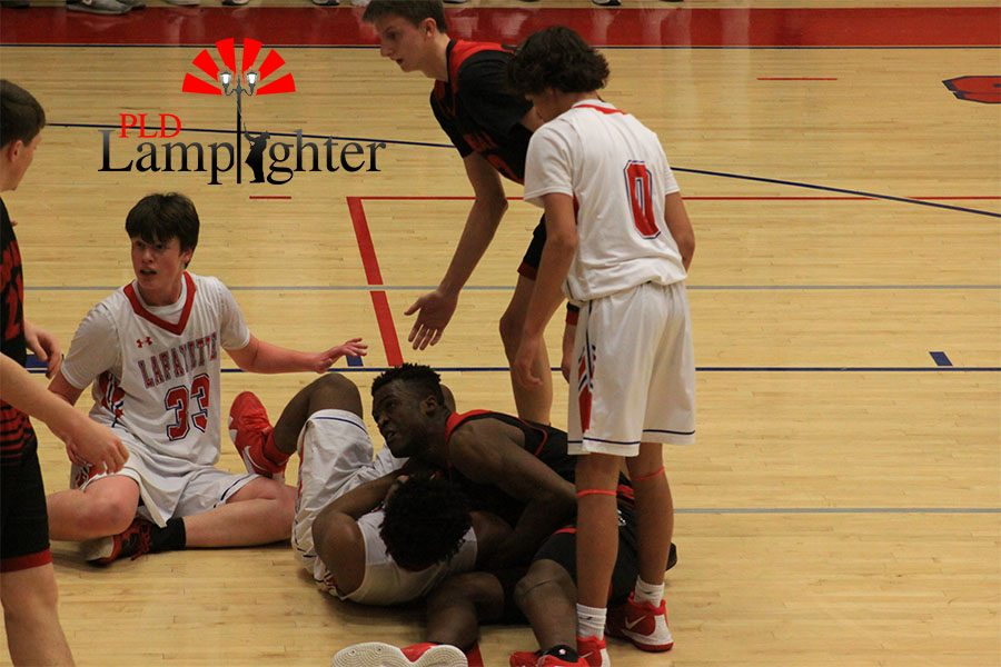 #25 Rabbi Kamona gets tangled up with Lafayette defender on the ground resulting in a jump ball.