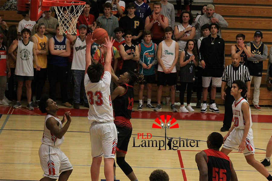 #23 Tim Hall takes the ball inside looking to score around jumping Lafayette defender.