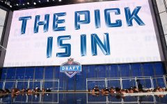 The stage from the 2018 NFL Draft. The screen is announcing that the next team's pick has come in from the front office.