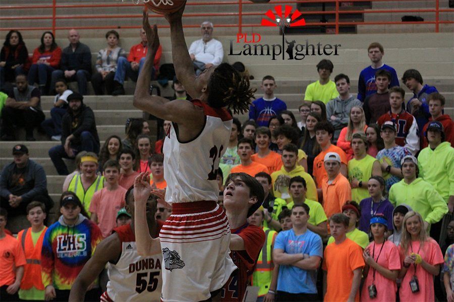 #23 Tim Hall grabs a rebound and puts it back up.