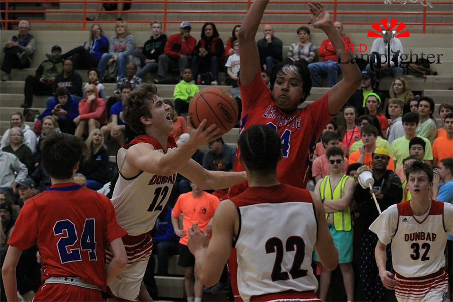 #12 Jared Gadd drives to the lane creating contact.