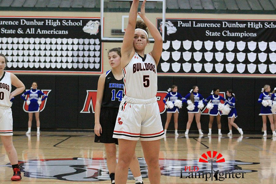 #5 Elise Ellison-Coons shooting a free throw after being fouled.