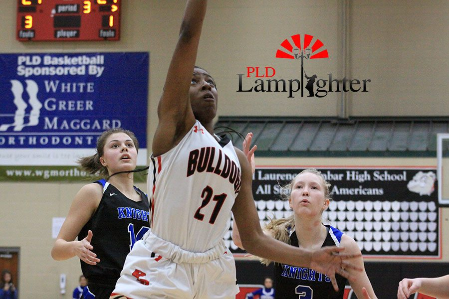 #21 Aziah Campbell going up for a layup.
