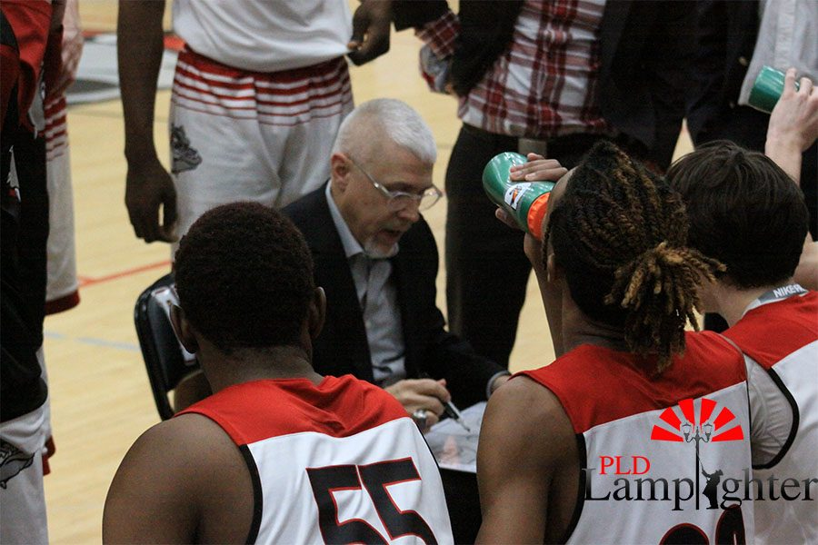 Coach Chalk setting up plays during a Dunbar timeout.