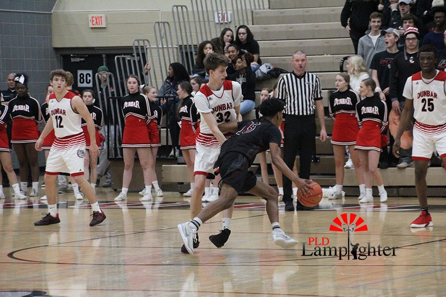 #32 Trevor Rogers tries to recover off of a Tates Creek drive to the basket.