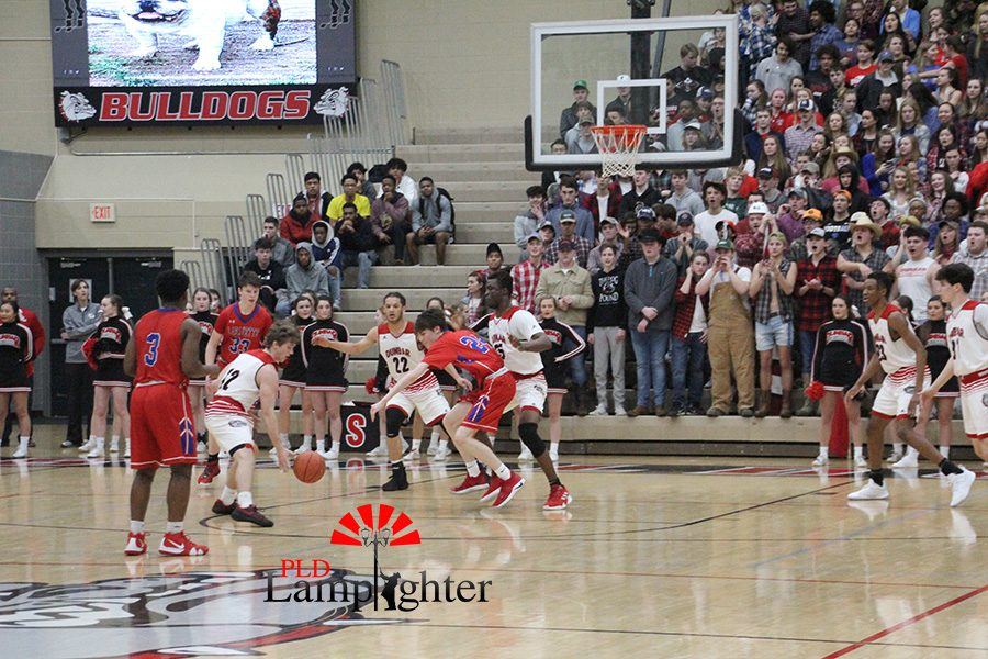 #12 Jared Gadd attempts to recover a loose ball to get possession.