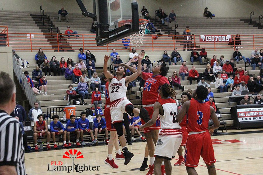 #22 Micheal Corio layups while being heavily guarded by Lafayette players.