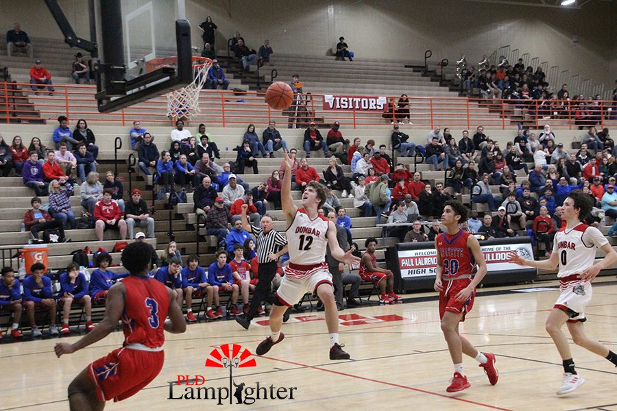 #12 Jared Gadd goes for a wide layup after breaking an opposing players ankles.