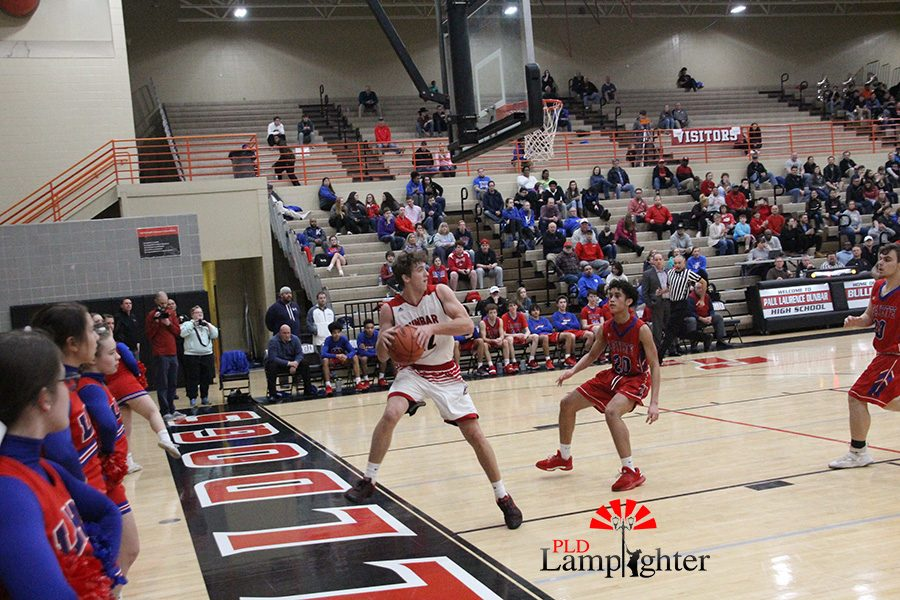#12 Jared Gadd jumps out of bounds to save a loose ball that would have caused a turn over.