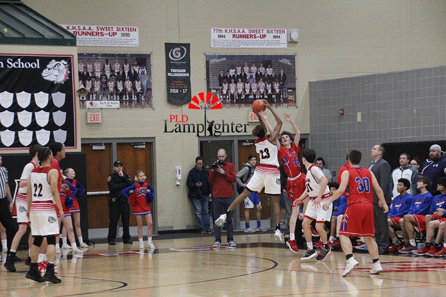 #23 Tim Hall steals the ball of out a Lafayette player's hand.