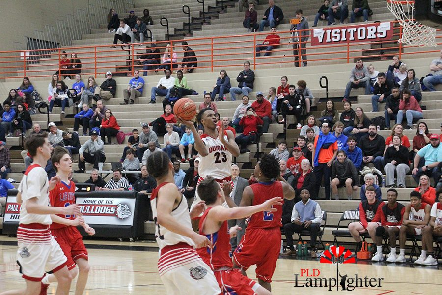 #23 Tim Hall attempts a layup over a Lafayette player.