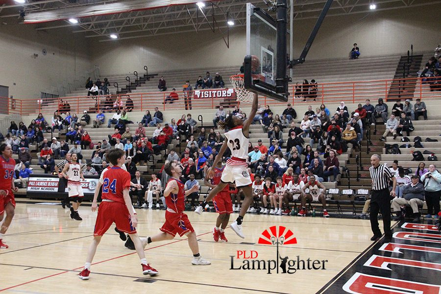#23 Tim Hall goes for a layup after breaking through Lafayette's defense.