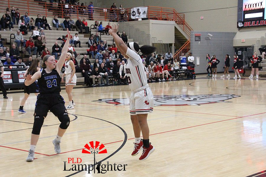#23 Tanaya Cecil shooting a three-pointer outside the paint.