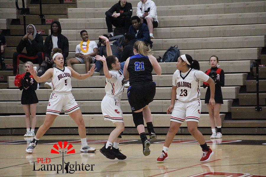 Dunbar players guarding an opponent.