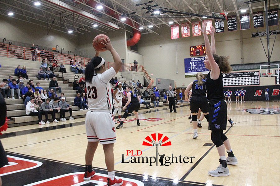 #23 Tanaya Cecil looking for an open pass in bounds.