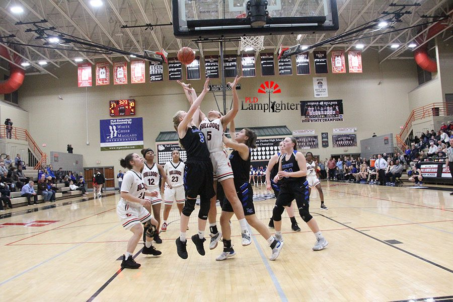 #5 Elise Ellison-Coons reaching for the rebound.