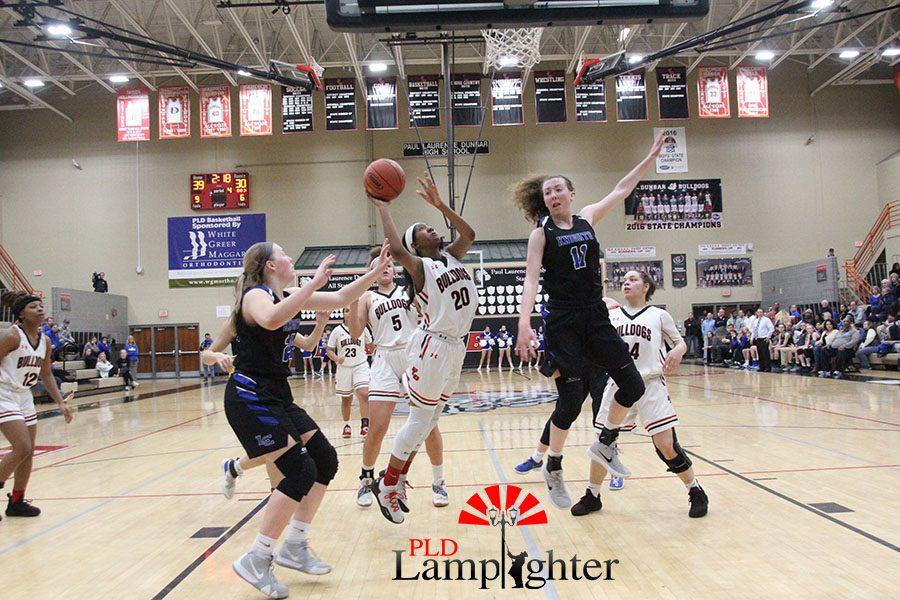 #20 Cheyenne Fullwood going up for a layup.