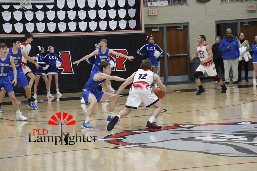 #12 Jared Gadd drives towards the basket.