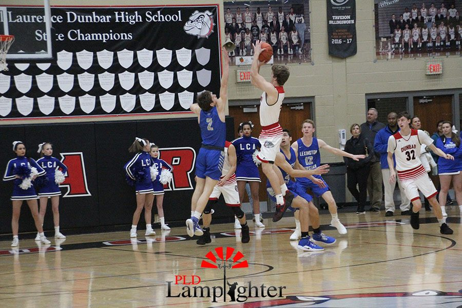 #12 Jared Gadd going up for a jump shot.