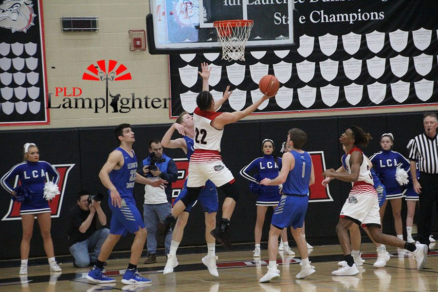#22 Michael Corio going up for a layup.
