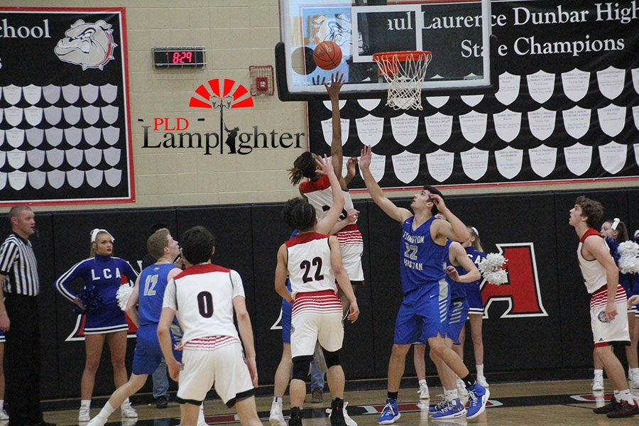#23 Tim Hall shooting a layup.