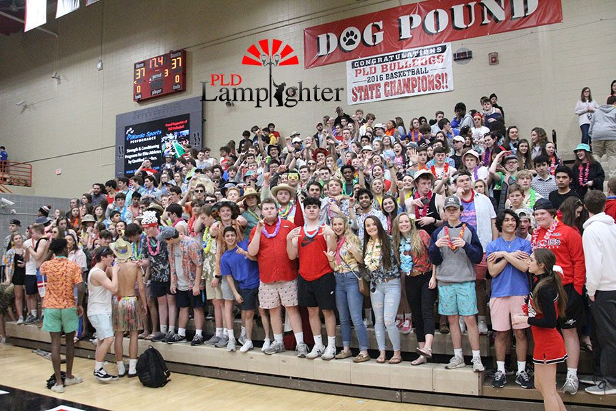 The Dog Pound cheering on the Bulldogs with a beach theme.