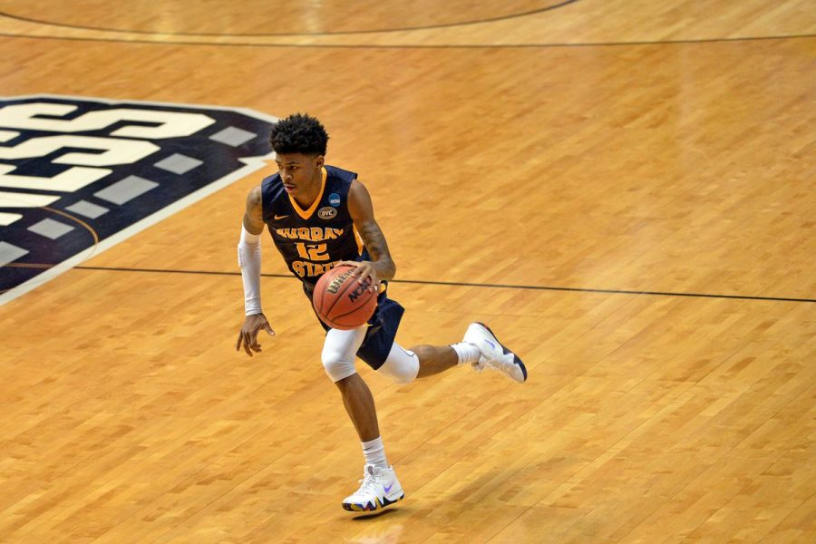 #12 Ja Morant drives the ball to the hoop on a fastbreak.