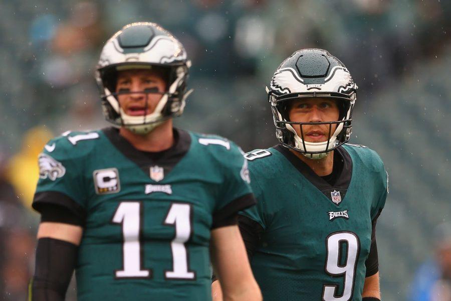 Quarterbacks Carson Wentz and Nick Foles standing together in uniform.