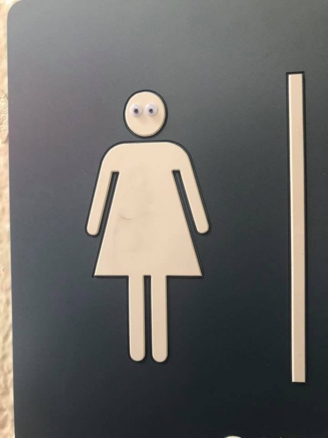 A bathroom sign became a little more lively with the addition of eyes.