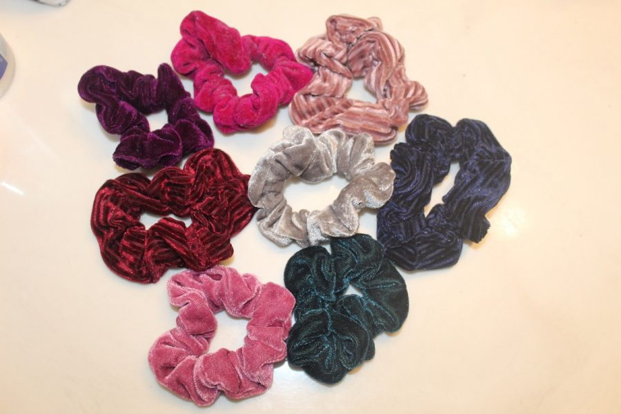 Eight different colored hair scrunchies, the latest in 2019 fashion. They are making an 80s comeback.