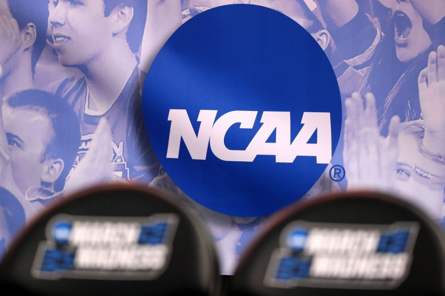 The NCAA logo with two empty chairs from March Madness.