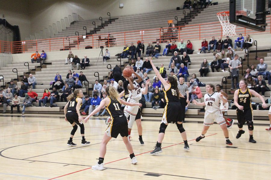 #20 Cheyenne Fullwood drives the lane and gets fouled while attempting a shot.