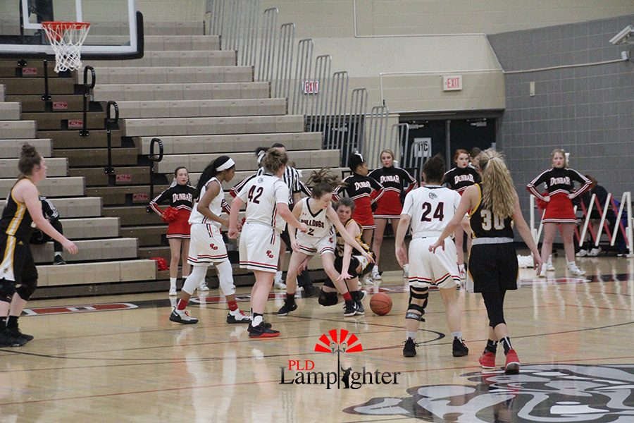 #2 Carly Henshaw lunges for a loose ball to try and get possession of the ball.